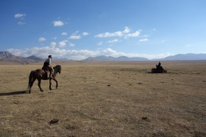 "JAKARTA DISORDER-Tour: ""Bir Duino Kyrgyzstan 2014"", Ascan Breuer with nomad's horse on the high plains"
