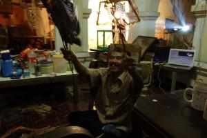 Dalang in action: Tardjono Wignyopranoto (Wayang master)